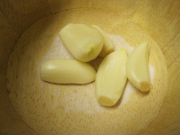 garlic cloves and salt