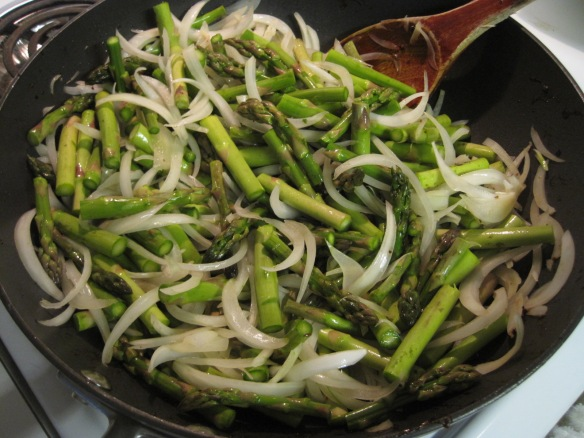 stir-frying onions and asparagus