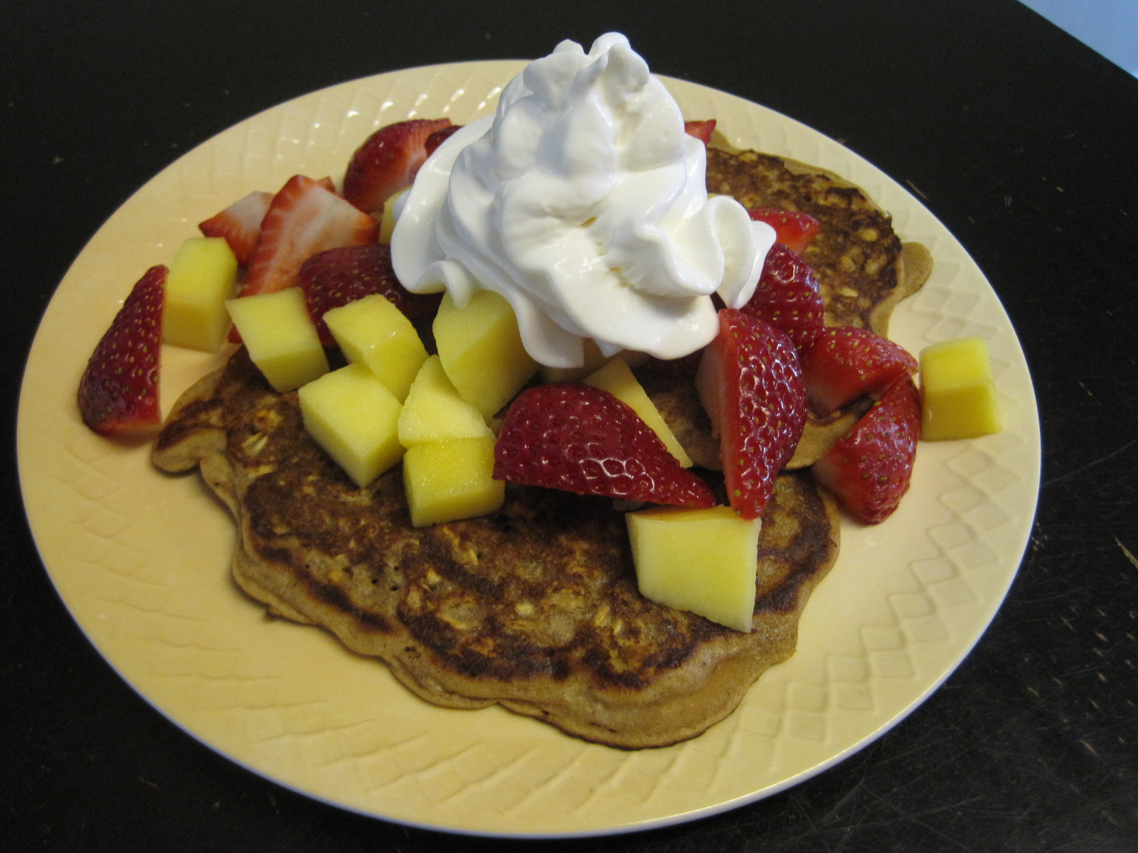 topped my pancakes with mangoes, strawberries, and a dollop of ...